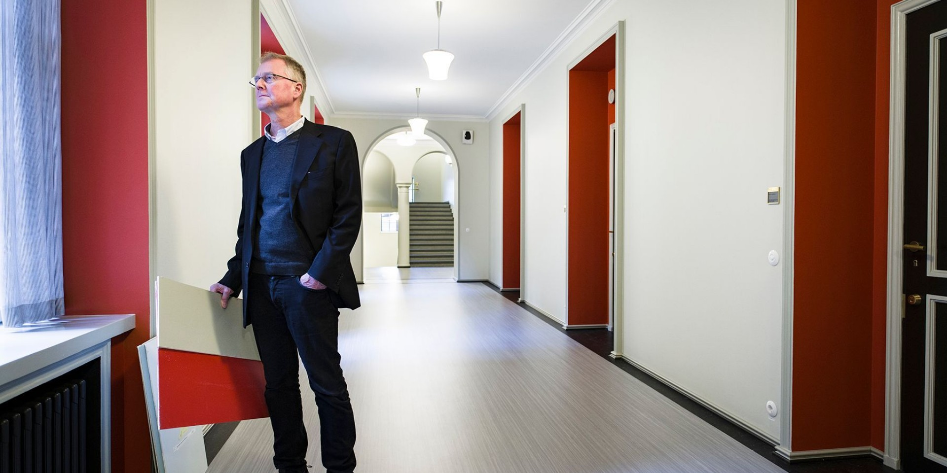 Architect Peter Verhe, the main designer of the refurbishment of the Parliament House, in the repainted corridor of the third floor of the main building.