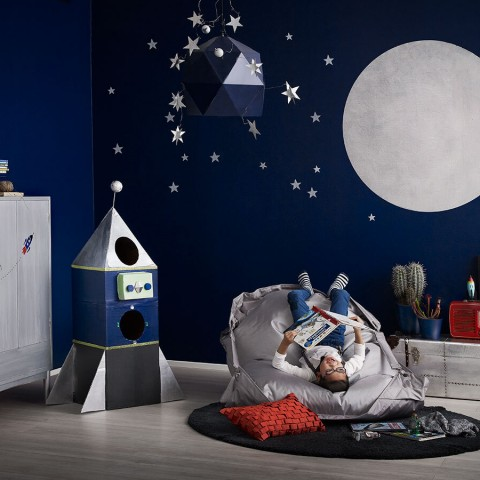 kids room with blue wall and painted with silver moon