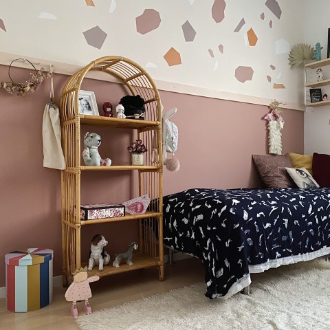 muted pink colour wall in kids room with colourful decorations