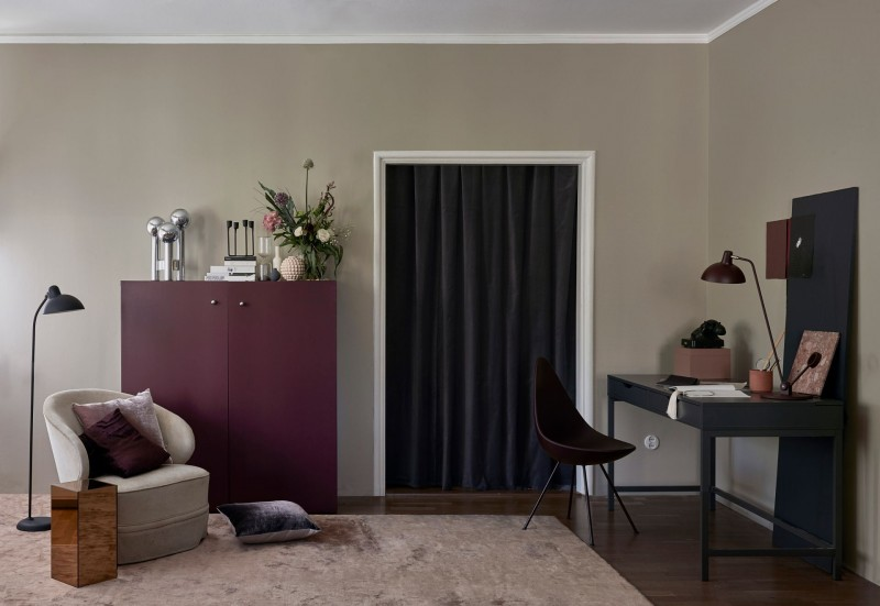 beige colour wall in living room, brown colour cabinet and table