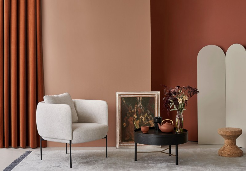 terracotta colour wall living room with beige colour furnitures